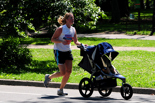 woman runing with baby